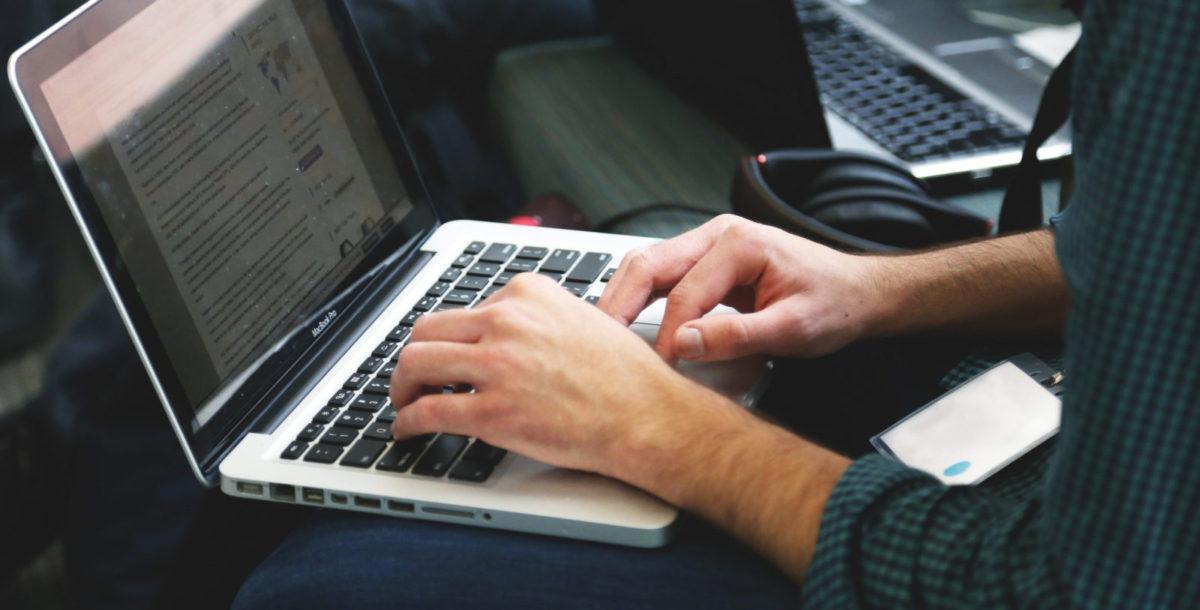 man-working-on-computer